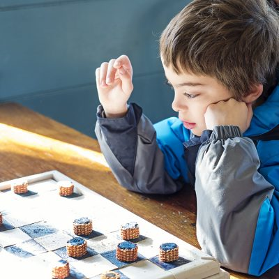 Playing checkers at Old Bethpage Village Restoration