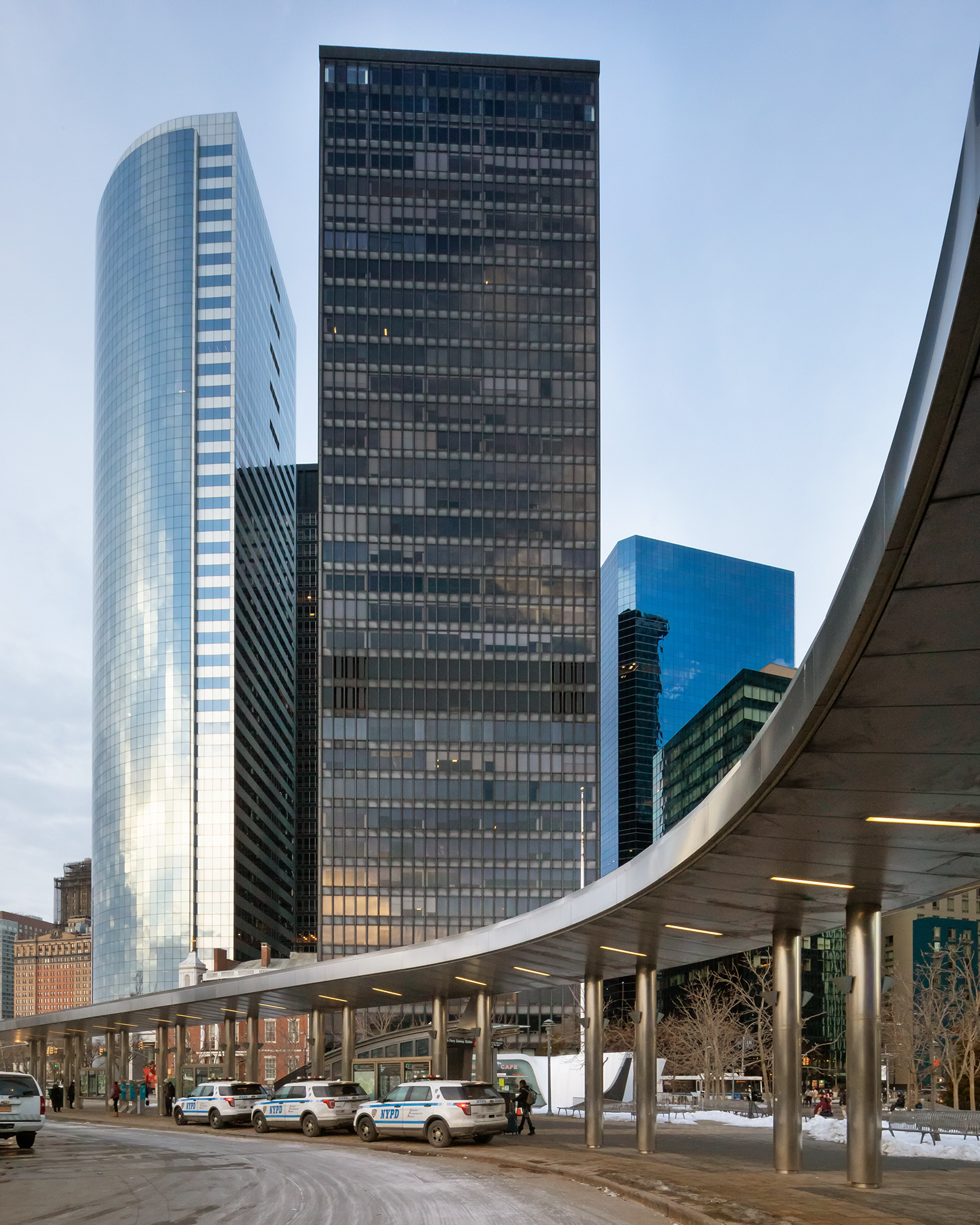 Manhattan's Financial District skyscrapers with covered walkway in the front